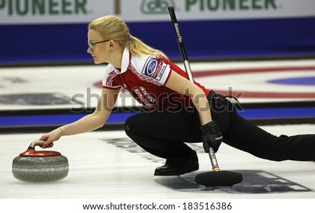 SAINT JOHN, CANADA - March 19: Russia's Alexandra Saitova delivers a stone at the Ford World Women's Curling Championship March 19, 2014 in Saint John, Canada. - stock photo