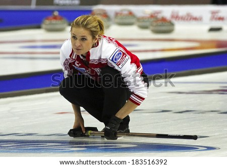 SAINT JOHN, CANADA - March 19: Russia's Margarita Fomina follows her shot at the Ford World Women's Curling Championship March 19, 2014 in Saint John, Canada. - stock photo
