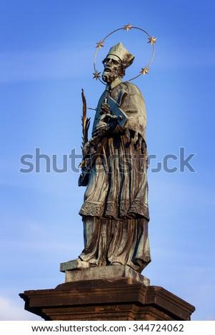 Saint John of Nepomuk on the famous charles bridge in prague - stock photo