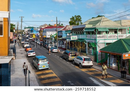 SAINT JOHN'S, ANTIGUA - AUGUST 24: downtown view of St Mary's street on August 24, 2011 in Saint John's, Antigua. It is the commercial centre of the nation and the chief port of the island of Antigua. - stock photo
