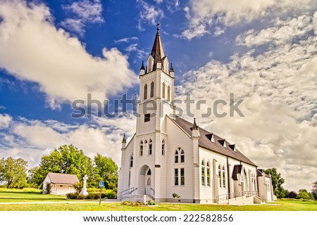 Saint John the Baptist Catholic Church is officially designated as one of the painted churches in Schulenburg Texas. - stock photo