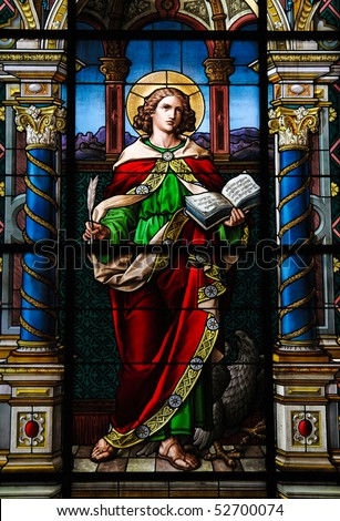 Saint John the Evangelist. Stained glass window created by F. Zettler (1878-1911) at the German Church (St. Gertrude's church) in Gamla Stan, Stockholm. - stock photo