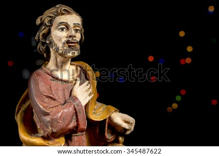 Saint Joseph with colorful stars at background. Nativity scene figures. Christmas traditions. - stock photo