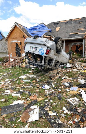 SAINT LOUIS, MISSOURI - APRIL 22: Debris from destroyed homes and property, including overturned vehicles after tornadoes hit the Saint Louis area on Friday, April 22, 2011.