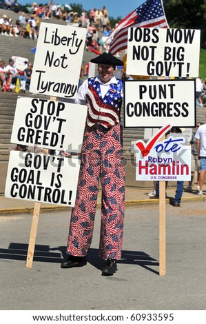 SAINT LOUIS, MISSOURI - SEPTEMBER 12: Man dressed in patriot costume holding signs at rally of the Tea Party Patriots in Downtown Saint Louis under the Arch, on September 12, 2010 - stock photo