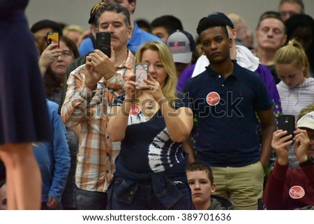 Saint Louis, MO, USA - March 12, 2016: Ted Cruz supporters snap photos of Carly Fiorina as she stumps for the Republican presidential candidate in a crowded Parkway West High School gymnasium. - stock photo
