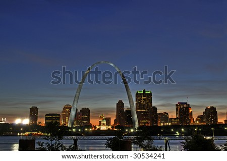 Saint Louis Skyline with the Mississippi river in front after sunset - stock photo