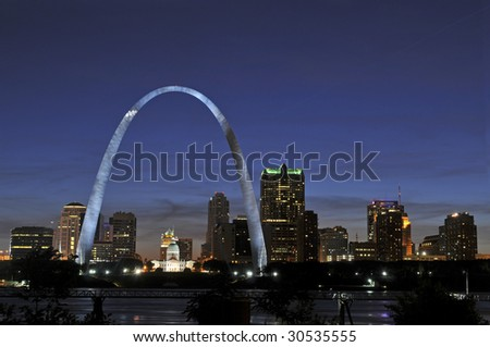 Saint Louis Skyline with the Mississippi river in front at night - stock photo