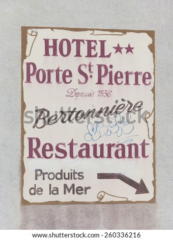 SAINT-MALO, FRANCE - JULY 6, 2011: Vintage billboard of Hotel Porte St. Pierre in Saint-Malo, France. The hotel is located in the heart of the historic town. - stock photo