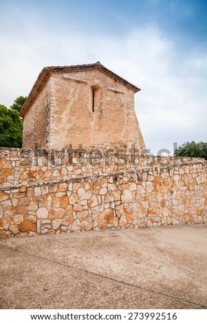 Saint Michael church in Calafell town, Spain. It is a work of transaction from Romanic to Gothic style, was shaped in XIII century, has two apses, one consecrated to St. Miahael, another to St. Mary - stock photo