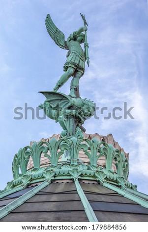 Saint-Michel statue on the top of Notre Dame de Fourviere basilica, Lyon, France - stock photo