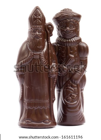 Saint Nicholas and Black Pete chocolate isolated on white - stock photo