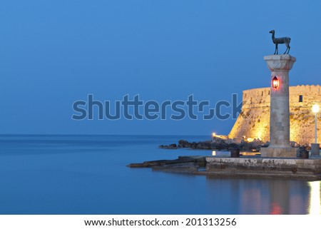Saint Nikolaos fortress and the statue of the Deer at Rhodes island in Greece - stock photo