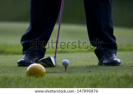 SAINT-OMER, FRANCE. 16-06-2010, A golfer lines up a tee shot at the European Tour, 14th Open de Saint-Omer, part of the Race to Dubai tournament and played at the AA Saint-Omer Golf Club . - stock photo