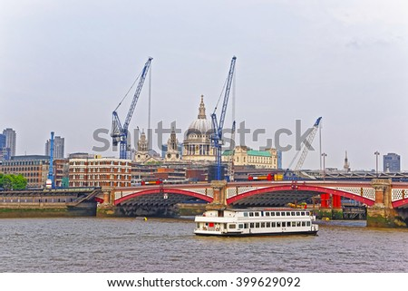 Saint Paul Cathedral and Blackfriars Bridge on Northern Bank of River Thames in London, UK. Saint Paul Cathedral is Anglican church. Blackfriars Bridge is traffic and road bridge over Thames River - stock photo