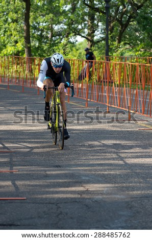 SAINT PAUL, MN/USA - JUNE 17, 2015: Pro cyclist Colin Strickland races in Stage One time trial at the prestigious North Star Grand Prix pro cycling event in Saint Paul. - stock photo