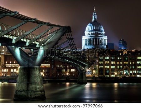 Saint Paul's Cathedral over Millennium Bridge in London - stock photo