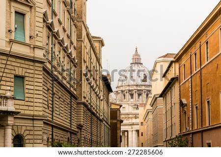 Saint Peter, Basilica in Vatican City: dome and facade from the streets of Rome - stock photo