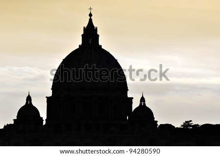 Saint Peter's Basilica dome silhouette in Vatican City, Rome. - stock photo