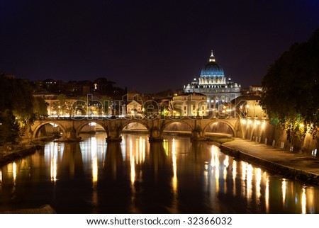 Saint Peter's Basilica in Rome by night, with reflection on the Tiber river - stock photo