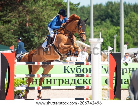SAINT PETERSBURG-JULY 06: Rider Valeriya Sokolova on Sir Stanwelll in the CSI3*-W/CSIYH1* International Jumping Grand Prix FEI World Cup Competition 160cm on July 06, 2014 in Saint Petersburg, Russia.