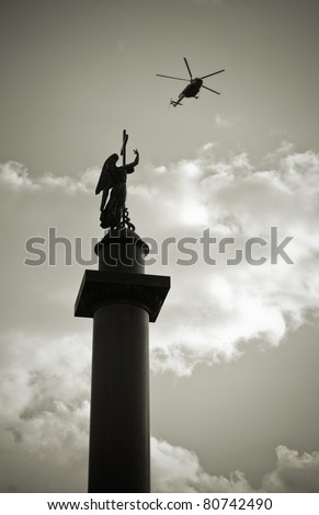 Saint Petersburg, Russia. Alexander column on Palace square with helicopter flying by