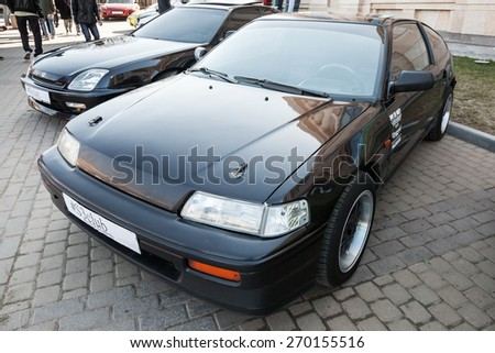 Saint-Petersburg, Russia - April 11, 2015: Black sporty classical Honda Civic CRX stands parked on the city street - stock photo