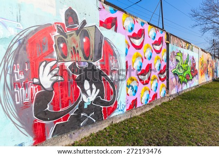 Saint-Petersburg, Russia - April 6, 2015: Colorful graffiti with cartoon character over old gray concrete walls