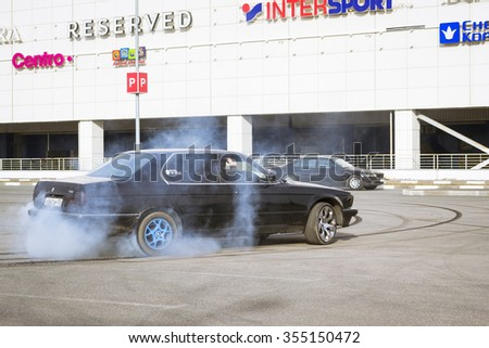 SAINT-PETERSBURG, RUSSIA - APRIL 5, 2014: Old-car BMW 7-series drifting at the meeting fans of the Bavarian automaker, St. Petersburg, Russia - stock photo