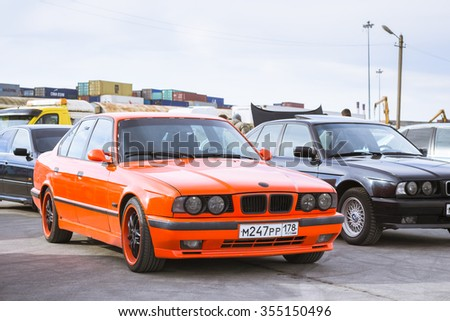 SAINT-PETERSBURG, RUSSIA - APRIL 5, 2014: Old-car BMW 5-series e34 at the meeting fans of the Bavarian automaker, St. Petersburg, Russia - stock photo