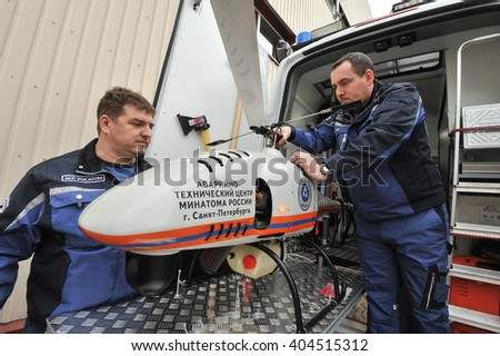 Saint-Petersburg, Russia - April 6, 2016: Preparation of an unmanned helicopter to a two-hour flight in the area of radiation accident radiation measurement, photography and videography