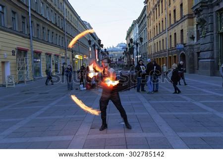 SAINT PETERSBURG, RUSSIA - APRIL 22:Street performers in Saint Petersburg, Russia on April 22, 2015. - stock photo