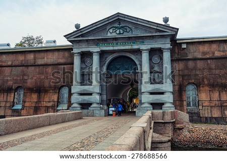 SAINT PETERSBURG, RUSSIA - AUGUST 25, 2014: Entrance to the Peter and Paul fortress in cloudy weather day. Historical citadel and popular landmark in the city  - stock photo