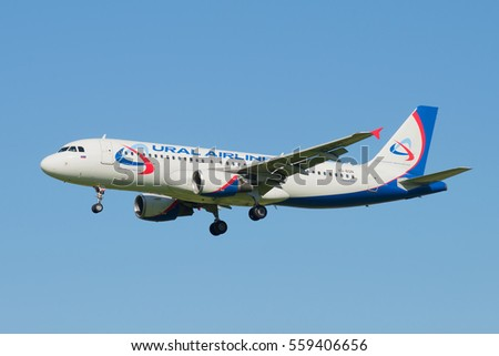 "SAINT PETERSBURG, RUSSIA - AUGUST 24, 2016: Flying the Airbus A320 (VQ-BQN) of airline ""Ural airlines"" in the blue cloudless sky"