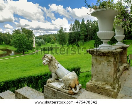 Saint Petersburg, Russia, August 18, 2016: historic lion sculptures at the stairs of the Royal Palace in Pavlovsk Park. Old staircase with vases and lions. Landmark tourist destination.