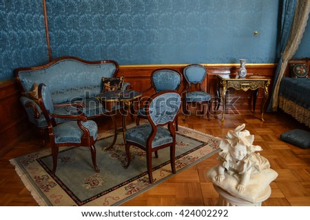 Saint Petersburg, Russia - August 11, 2012 - Interior of antique bedroom. Sofa, armchairs, chairs, coffee table, rug. Sculpture, marble, child. Yusupov Palace. - stock photo
