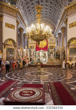 SAINT PETERSBURG, RUSSIA - AUGUST 9, 2014: Orthodox Christians inside the Kazan Cathedral