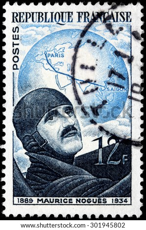 SAINT-PETERSBURG, RUSSIA - JULY 14, 2015: A stamp printed by France shows image portrait of famous French aviator Maurice Nogues, circa October, 1951. - stock photo