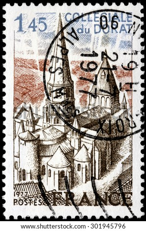 SAINT-PETERSBURG, RUSSIA - JULY 14, 2015: A stamp printed by FRANCE shows view of Collegiate church of Le Dorat - a commune in the Limousin region in western France, circa July, 1977 - stock photo