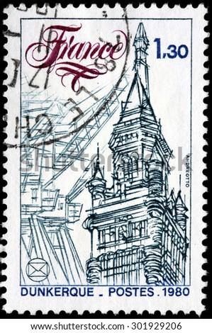 SAINT-PETERSBURG, RUSSIA - JULY 14, 2015: A stamp printed by FRANCE shows view of the Dunkirk Town Hall. Dunkirk is a commune in the Nord department in northern France, circa May, 1980 - stock photo