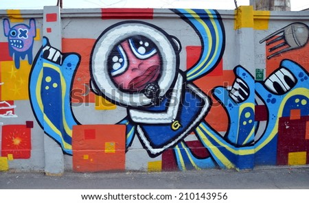 SAINT-PETERSBURG, RUSSIA, JULY 23, 2014: Bright graffiti on a  wall in St. Petersburg, Russia - stock photo