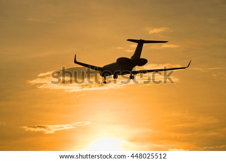 SAINT PETERSBURG, RUSSIA - JULY 03, 2016: The Bombardier BD-700-1A11 Global 5000 M-KBSD) flying in sunset sky