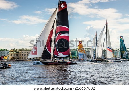 SAINT-PETERSBURG, RUSSIA - JUNE 28, 2014: Alinghi (Switzerland) is the winner of Act 4 of the Extreme Sailing Series catamarans race on 26th-29th June 2014 in St. Petersburg - stock photo
