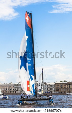 SAINT-PETERSBURG, RUSSIA - JUNE 28, 2014: Catamaran Realteam (Switzerland) at the Extreme Sailing Series catamarans race on 26th-29th June 2014 in St. Petersburg - stock photo