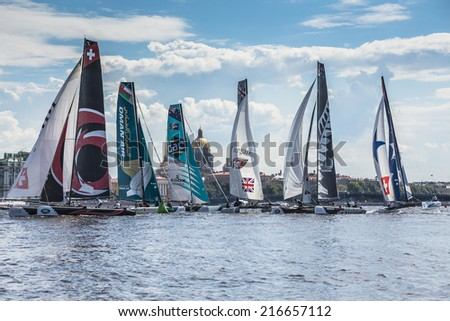SAINT-PETERSBURG, RUSSIA - JUNE 28, 2014: Participants of Act 4 of the Extreme Sailing Series catamarans race on 26th-29th June 2014 in St. Petersburg - stock photo