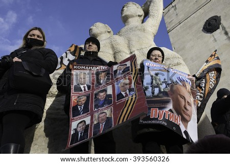 Saint-Petersburg, Russia - March 18, 2016: the rally on the occasion of the second anniversary of the reunion of Crimea to Russia, Participants of the rally with banners and posters President Putin. - stock photo