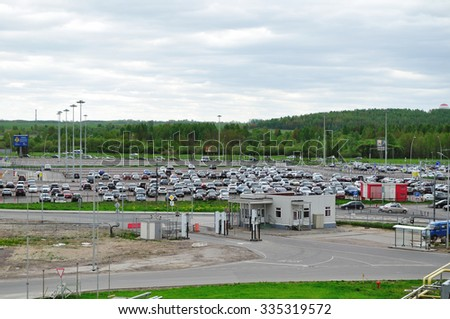 SAINT-PETERSBURG, RUSSIA - MAY 23, 2015.  Aerial view of airport auto crowded parking lot in Pulkovo International airport in Saint-Petersburg, Russia