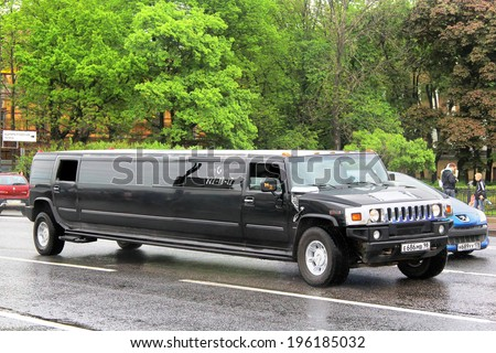 SAINT PETERSBURG, RUSSIA - MAY 26, 2013: Black Hummer H2 limousine at the city street.