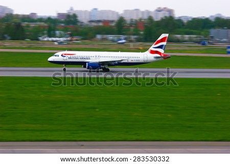 SAINT-PETERSBURG, RUSSIA - MAY 23, 2015.  British Airways Airbus A320-232 aircraft (registration number G-EUUZ) prepares for take-off from the runway of Pulkovo International Airport  - stock photo