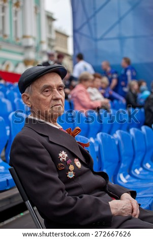 Saint Petersburg /RUSSIA - MAY 9: Old   veteran of  WWII  decorated with  medals during festivities devoted to anniversary of Victory Day on May 9, 2013 in Saint- Petersburg